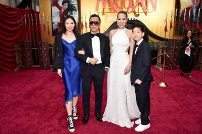 HOLLYWOOD, CALIFORNIA - MARCH 09: (L-R) Jasmine Yen, Donnie Yen, Cissy Wang, and James Yen attend the World Premiere of Disney's 'MULAN' at the Dolby Theatre on March 09, 2020 in Hollywood, California. (Photo by Alberto E. Rodriguez/Getty Images for Disney)