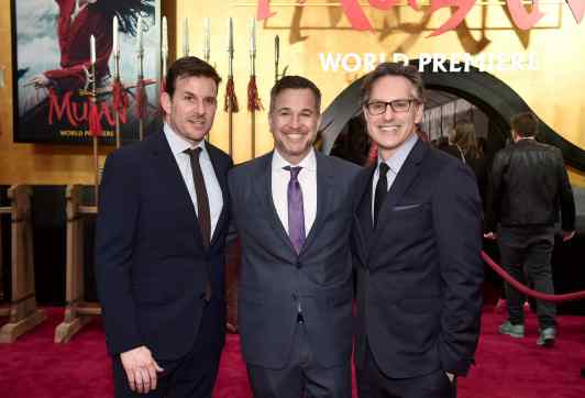 HOLLYWOOD, CALIFORNIA - MARCH 09: Producers Chris Bender, Jake Weiner and Jason T. Reed attend the World Premiere of Disney's 'MULAN' at the Dolby Theatre on March 09, 2020 in Hollywood, California. (Photo by Alberto E. Rodriguez/Getty Images for Disney)