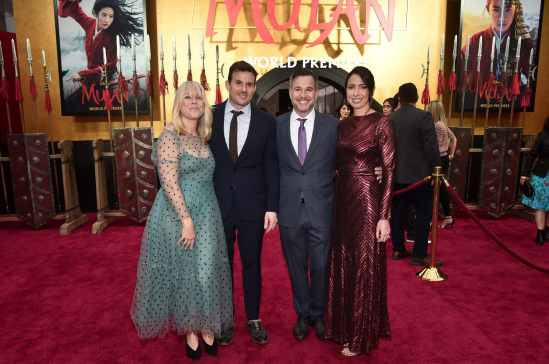 HOLLYWOOD, CALIFORNIA - MARCH 09: Kristi Bender, Chris Bender and Jake Weiner and Maurine Slutsky attend the World Premiere of Disney's 'MULAN' at the Dolby Theatre on March 09, 2020 in Hollywood, California. (Photo by Alberto E. Rodriguez/Getty Images for Disney)