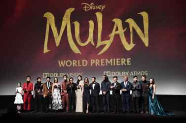 HOLLYWOOD, CALIFORNIA - MARCH 09: (L-R) Crystal Rao, Chen Tang, Nelson Lee, Jimmy Wong, Rosalind Chao, Yoson An, Jet Li, Yifei Liu, Director Niki Caro, Donnie Yen, Jason Scott Lee, Tzi Ma, Ron Yuan, Jun Yu, Doua Moua, and Xana Tang speak onstage during the World Premiere of Disney's 'MULAN' at the Dolby Theatre on March 09, 2020 in Hollywood, California. (Photo by Alberto E. Rodriguez/Getty Images for Disney)