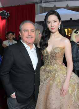 HOLLYWOOD, CALIFORNIA - MARCH 09: Co-Chairman, The Walt Disney Studios Alan Bergman and Yifei Liu attend the World Premiere of Disney's 'MULAN' at the Dolby Theatre on March 09, 2020 in Hollywood, California. (Photo by Charley Gallay/Getty Images for Disney)