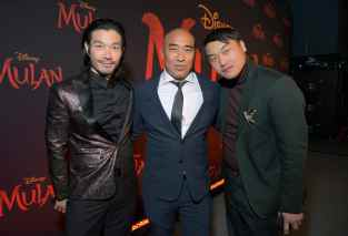 HOLLYWOOD, CALIFORNIA - MARCH 09: (L-R) Nelson Lee, Ron Yuan, and Doua Moua attend the World Premiere of Disney's 'MULAN' at the Dolby Theatre on March 09, 2020 in Hollywood, California. (Photo by Charley Gallay/Getty Images for Disney)