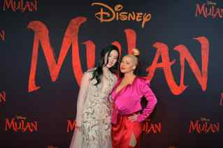 HOLLYWOOD, CALIFORNIA - MARCH 09: Yifei Liu and Christina Aguilera attend the World Premiere of Disney's 'MULAN' at the Dolby Theatre on March 09, 2020 in Hollywood, California. (Photo by Charley Gallay/Getty Images for Disney)