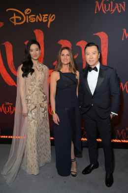HOLLYWOOD, CALIFORNIA - MARCH 09: (L-R) Yifei Liu, Director Niki Caro, and Donnie Yen attend the World Premiere of Disney's 'MULAN' at the Dolby Theatre on March 09, 2020 in Hollywood, California. (Photo by Charley Gallay/Getty Images for Disney)
