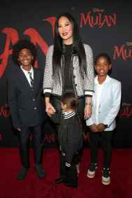 HOLLYWOOD, CALIFORNIA - MARCH 09: Kimora Lee Simmons (C) and guests attend the World Premiere of Disney's 'MULAN' at the Dolby Theatre on March 09, 2020 in Hollywood, California. (Photo by Jesse Grant/Getty Images for Disney)