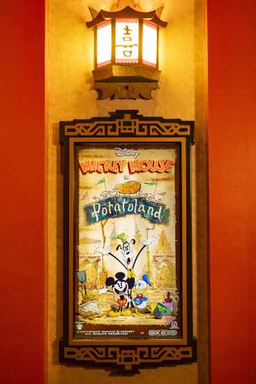"""A poster for the """"Mickey Mouse"""" cartoon short """"Potatoland"""" was created by Disney Television Animation for Mickey & Minnie's Runaway Railway, which opens March 4, 2020, in Disney's Hollywood Studios at Walt Disney World Resort in Lake Buena Vista, Fla. """"Potatoland"""" is one of several """"Mickey Mouse"""" posters guests find in the lobby of the Chinese Theatre as they prepare to experience the new ride-through attraction featuring Mickey Mouse and Minnie Mouse. (Matt Stroshane, photographer)"""