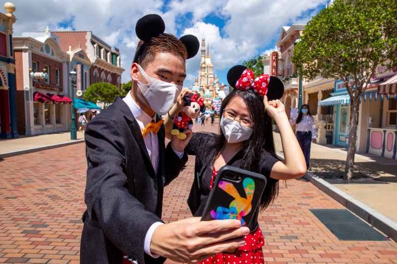 Guests enjoy the reopening of Hong Kong Disneyland on its reopening day.
