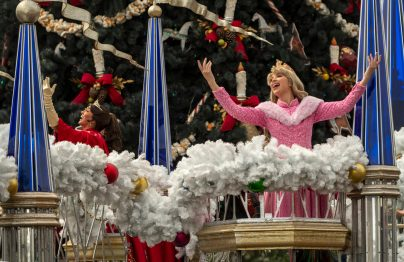 Dressed in their holiday finest, Elena (left) and Aurora (right) wave to guests during a cavalcade down Main Street, U.S.A., with other Disney princesses as part of the holiday celebrations at Magic Kingdom Park at Walt Disney World Resort in Lake Buena Vista, Fla. (Kent Phillips, photographer)