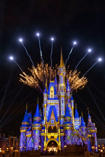 Pyrotechnic pixie-dust moments add occasional bursts of merriment each night at Magic Kingdom Park as projection effects transform Cinderella Castle with a flourish of holiday cheer. These magical holiday touches occur throughout the night as part of the seasonal celebrations happening across Walt Disney World Resort in Lake Buena Vista, Fla., through Dec. 30, 2020. (Matt Stroshane, photographer)