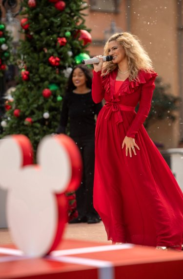 "Tori Kelly performs with the Florida A&M University Choir at EPCOT at Walt Disney World Resort in Lake Buena Vista, Fla. on Saturday, Dec. 5, 2020, during a taping of ""The Disney Parks Magical Christmas Celebration."" The holiday special will air on ABC on Dec. 25, 10am-12pm ET. (Kent Phillips, photographer)"