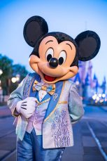"Beginning Oct. 1, 2021, Mickey Mouse will join Minnie Mouse as hosts of ""The World's Most Magical Celebration"" honoring Walt Disney World Resort's 50th anniversary in Lake Buena Vista, Fla. They will dress in sparkling new looks custom made for the 18-month event, highlighted by embroidered impressions of Cinderella Castle on multi-toned, EARidescent fabric punctuated with pops of gold. (Matt Stroshane, photographer)"