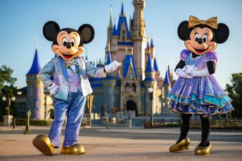 "Beginning Oct. 1, 2021, Mickey Mouse and Minnie Mouse will host ""The World's Most Magical Celebration"" honoring Walt Disney World Resort's 50th anniversary in Lake Buena Vista, Fla. They will dress in sparkling new looks custom made for the 18-month event, highlighted by embroidered impressions of Cinderella Castle on multi-toned, EARidescent fabric punctuated with pops of gold. (Matt Stroshane, photographer)"