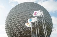 Flags of six original EPCOT icons were raised for the first time on March 3, 2021, at the main entrance of the Walt Disney World Resort theme park in Lake Buena Vista, Fla. The flags now flank Spaceship Earth and, along with new lighting and music in the entrance plaza, mark the latest milestone in the historic transformation of EPCOT currently underway. (David Roark, photographer)