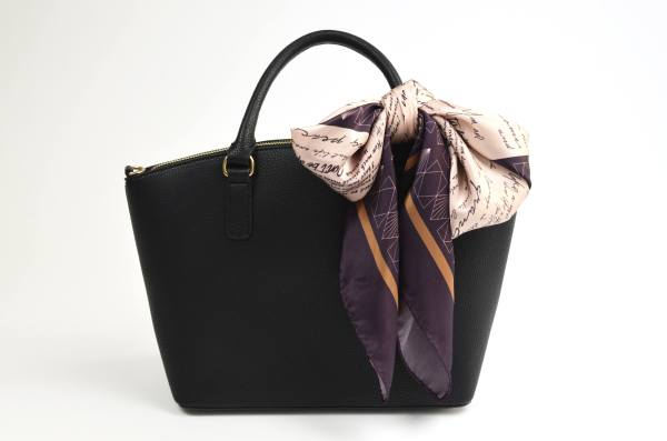 silk scarf tied to bag in a large bow