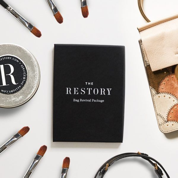 The Restory gift voucher pictured as a flatly surrounded by paint brushes and leather accessories