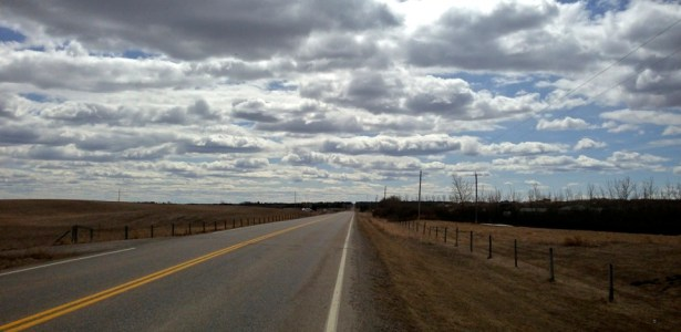 wide open road and prairie sky