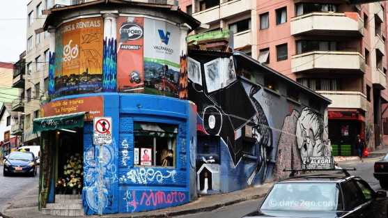 A small corner shop covered in street art - you see some themes repeated