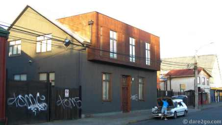 A contemporary renovation of an older house - still all clad in iron.