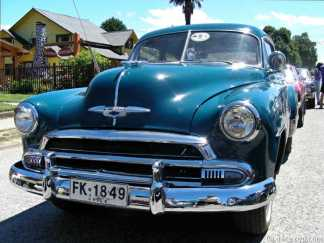 historic Chevrolet sedan with handheld search light