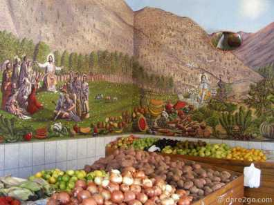 Vicuña: strange religious wallart in an ordinary vegetable shop