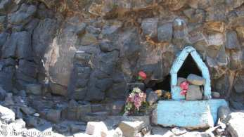 Very simple shrine, built into rock face, alongside Ruta 40, Neuquen Province, in Argentina.