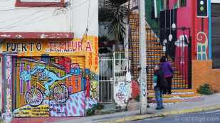 Street scene in Calle Ecuador (lower section): StreetArt on Sushi shop, colourful staircase, more art on neighbouring building