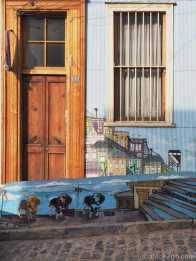 Valparaiso StreetArt: sometimes you have to keep your eyes open or you miss little gems, like these three stenciled dogs on a low wall, hiding behind parked cars.