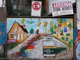 Valparaiso StreetArt: street scene with trolley bus and cars left out to dry (love the play on words)