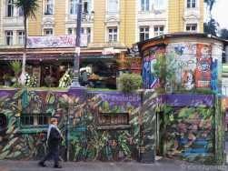 Valparaiso StreetArt: this jungle scene wraps around a block of public toilets.