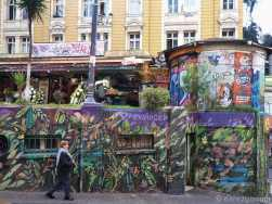 Valparaiso StreetArt: this jungle scene wraps around a block of public toilets.