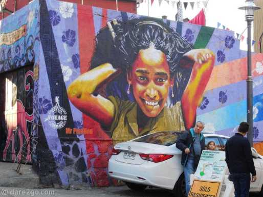 Valparaiso StreetArt: beautiful portrait of a young girl smiling (should I know her name?). Sometimes one can't help the mess in front of street art :p