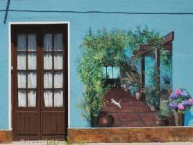 Trompe L'Oeil courtyard mural with cat