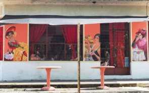Art Nouveau murals on a corner restaurant on Ramon Alvarez in Villa 25 de Agosto
