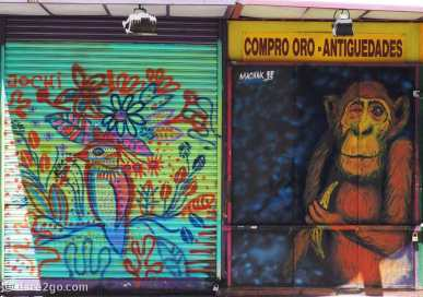 Street Art Calle Libertad: side-by-side two very different pieces