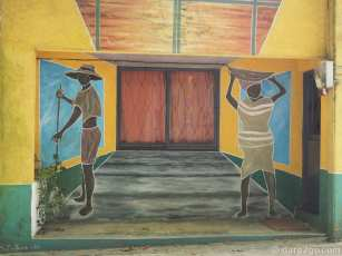 Two black people going about their business. This mural is just down from the corner building with perspective art.