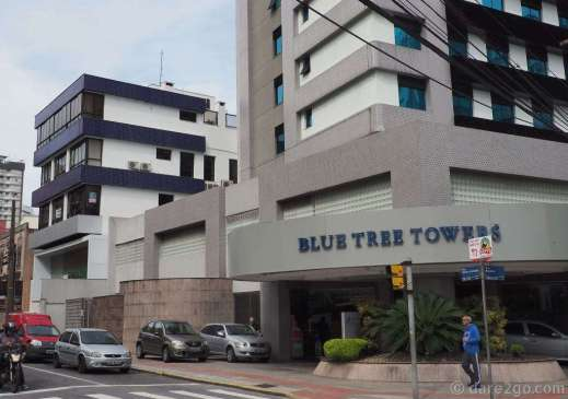 A residential building, called Blue Tree Towers (??), in Florianópolis. Most of its facade is tiled, as is part of the adjoining building.