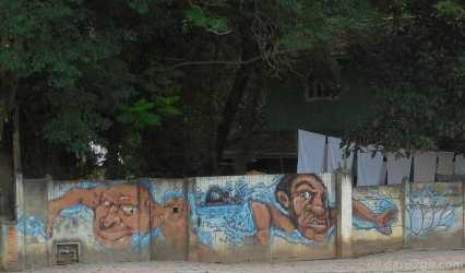 Florianópolis StreetArt: once you look closely this is a rather funny (and also serious) picture of two men swimming for their lives, trying to escape a shark baring its teeth.