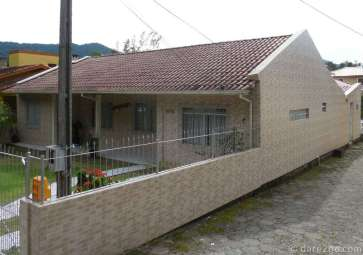 A fully tiled house in a small town somewhere in the South of Brazil. These are large tiles with a brick pattern.