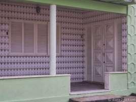 A completely tiled verandah of an old 50s or 60s beachside bungalow in Farol de São Tomé.