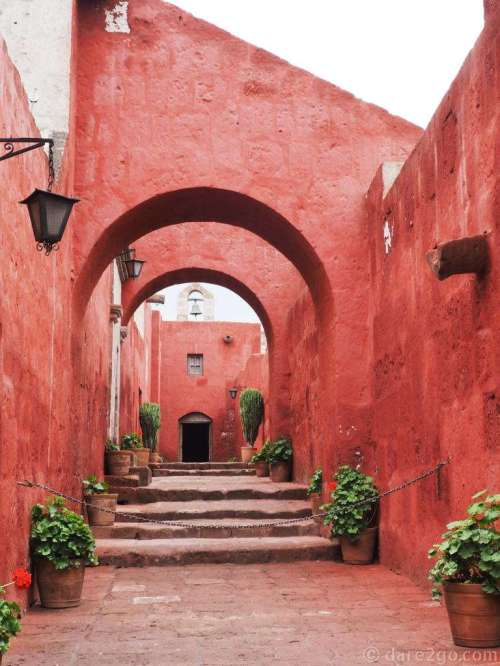 So many photogenic vistas inside the Santa Catalina convent - here in red with a chapel at the end.
