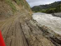 Here a landslide (from the right) dammed up the river, which consequently washed across the road and made a soggy mess.