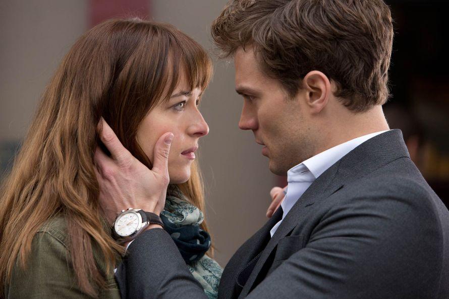 Dakota Fanning and Jamie Dornan in Fifty Shades of Grey