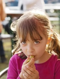 Little girl eating fermented foods