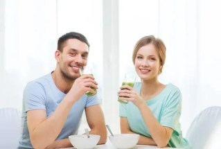Couple drinking green juice and Juice Fasting