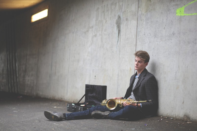 man-sitting-down-with-saxophone