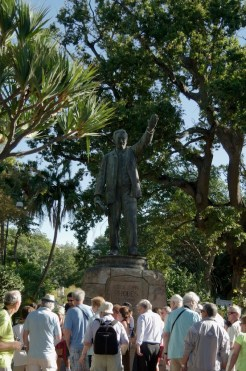 "Tourists admire Rhode's statue, which faces north, towards Africa in the centre of Cape Town. ""Your hinterland is there"""