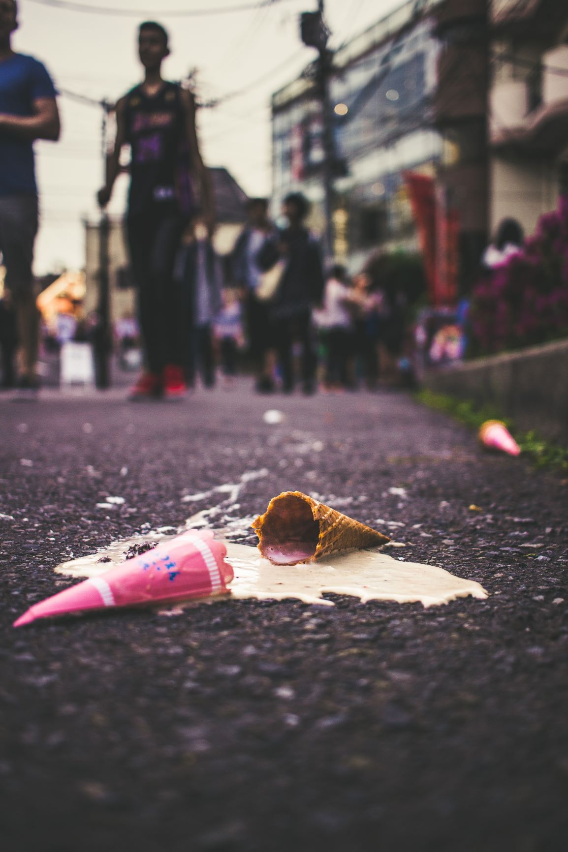 Icecream cone dropped on the ground and melted
