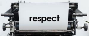 "Top section of a typewriter with the word ""respect"" on the page"