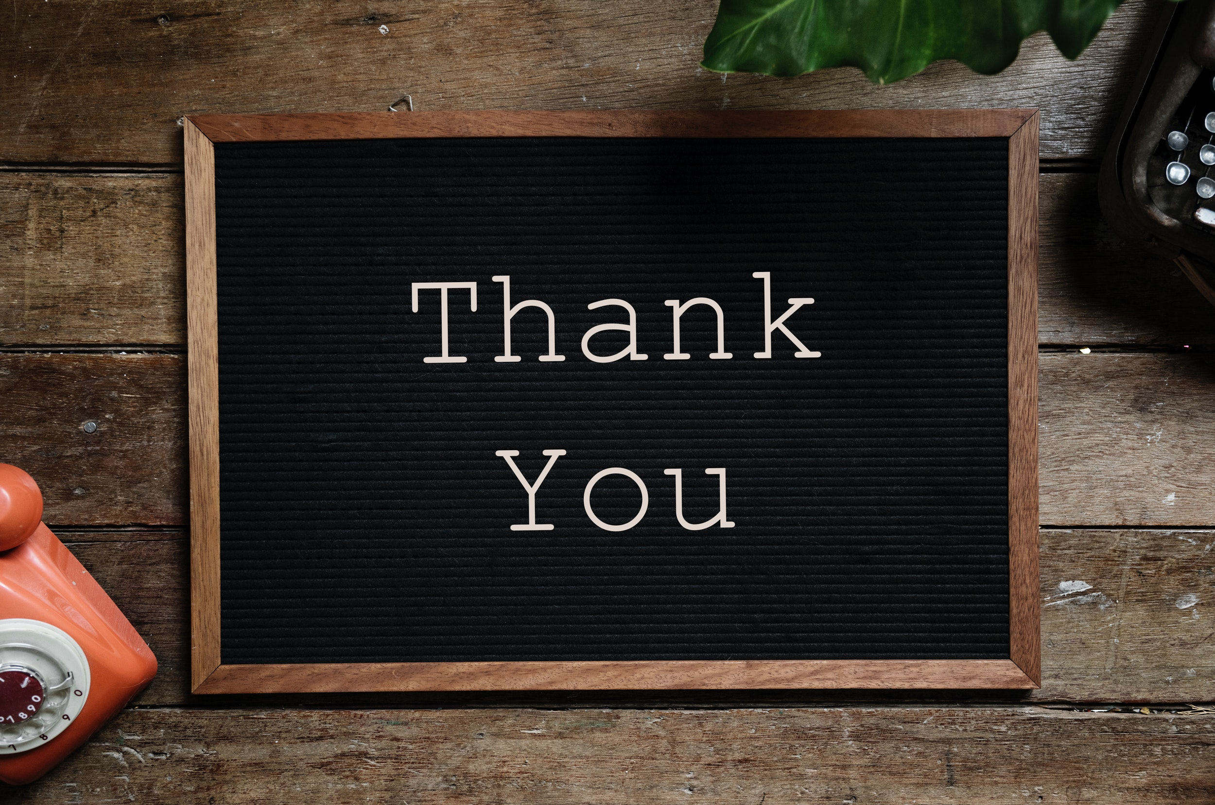 "Black noticeboard with white writing saying ""Thank You"""