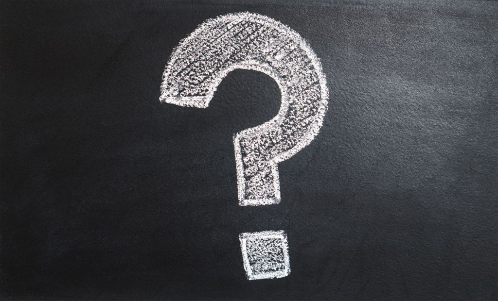 Blackboard with a question mark in white chalk